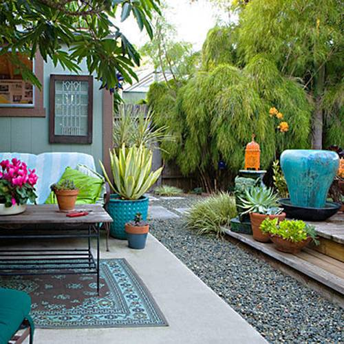 Small Yard Design Ideas comely small garden design with random floortile and black iron furniture bit wooden fence Ideas Small Backyard Garden Garden Design Ideas Small Backyard Designs 2